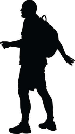 hiking: A silhouette of a man hiking with a backpack  Stock Photo