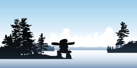 inukshuk: An Inukshuk on a point on a northern lake. Stock Photo