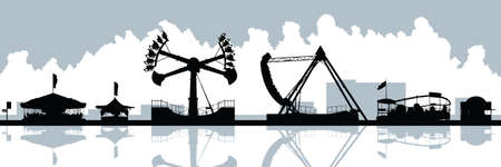Skyline silhouette of amusement park rides.