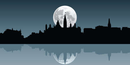 moonrise: A full moon rises behind the skyline of the city of Ottawa, Ontario, Canada.