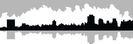 Skyline silhouette of Upper East Side in New York City, USA. View across reservoir in Central Park.
