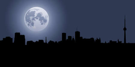Full moon above a skyline silhouette of the city of Toronto.