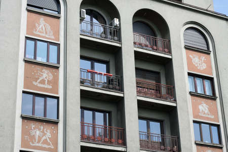 An unusual building with zodiac signs on it photo