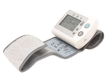 Blood pressure device. Electronic tensiometer and glucometer over white. Self-monitoring medical concept Stock Photo - 5611932