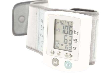 hypotension: Blood pressure device. Electronic tensiometer and glucometer over white. Self-monitoring medical concept  Stock Photo