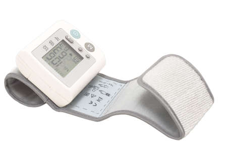 prophylaxis: Blood pressure device. Electronic tensiometer and glucometer over white. Self-monitoring medical concept  Stock Photo