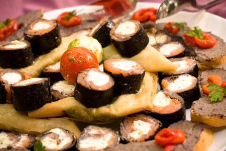 Detail of a delicious sushi plate with pie. Focus on the top tomato. Stock Photo - 7924074