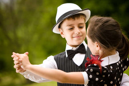 Lovely young couple dancing and having fun. Focus on the boy face. More images with the same models. photo