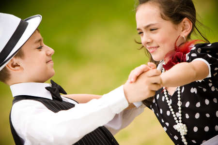 Lovely young couple dancing and having fun. More images with the same models.