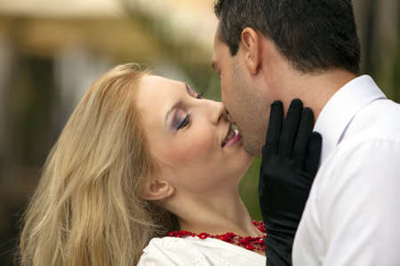 Lovely couple kissing. Focus on the womans face.  photo
