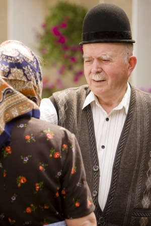Portrait of a romanian traditional very old couple on country side. Focus on the mans face expression. See more images with them. photo