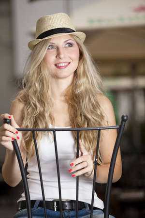 Lovely blond girl with a hat. See more image. photo