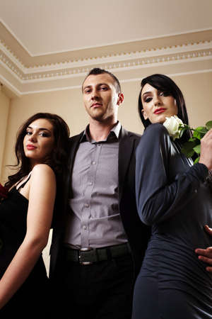 A man with two ladies. See more images from the same shoot. Stock Photo - 9800219
