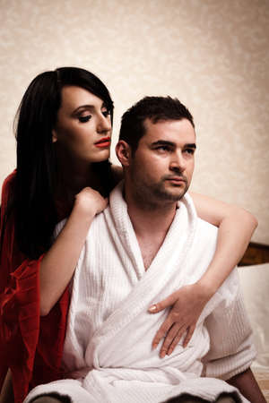 Two lovers in a hotel room having fun. See more images from the same shoot. Stock Photo - 9800217
