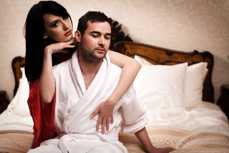 Two lovers in a hotel room having fun. See more images from the same shoot. photo