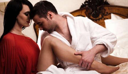 Two lovers in room having fun.