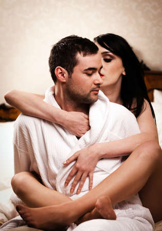 Two lovers in a hotel room having fun. See more images from the same shoot.