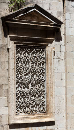 walled: Interresting walled window founded in surrounding buildings in Dublorvnik, Old City Placa, Croatia. Stock Photo