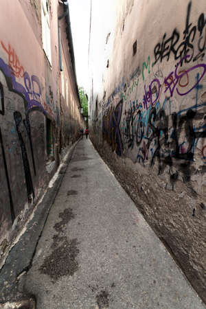 Narrow street with graffiti walls in Zagreb, Croatia. Stock Photo - 11245606