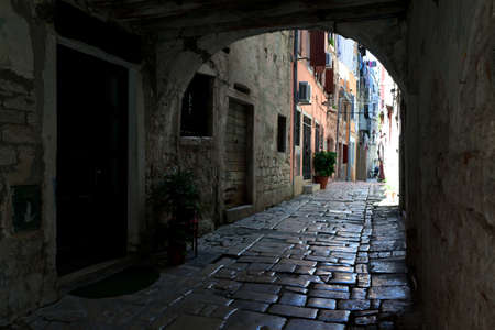Narrow streets, old pavement and very old buildings in Rovinj Old City, Croatia.