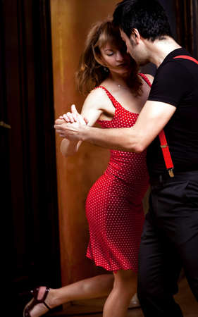 salsa dance: A man and a woman in the most romantic dance: tango. Please see more images from the same shoot. Stock Photo