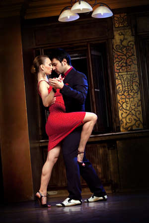 salsa dancing: A man and a woman dancing tango. Please see more images from the same shoot. Stock Photo