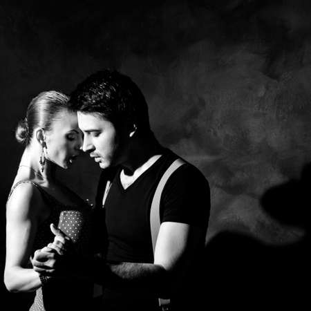 tangoing: A man and a woman in the most romantic dance: tango. Please see more images from the same shoot. Stock Photo