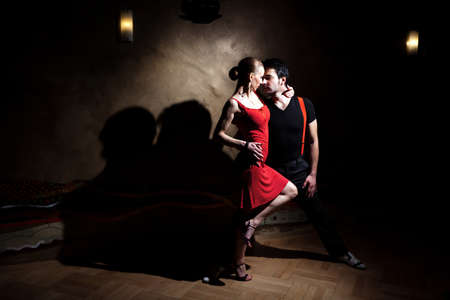 salsa dancing: A man and a woman in the most romantic dance: tango. Please see more images from the same shoot. Stock Photo
