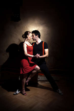 salsa dancing: Beautiful dancers performing an argentinian tango. Please check similar images from my portfolio.