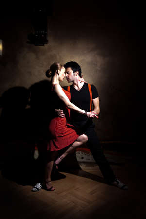 salsa dancer: Beautiful dancers performing an argentinian tango. Please check similar images from my portfolio.