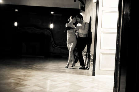 A man and a woman in the most romantic dance: tango. Black and white image with grain film added as effect. Please see more images from the same shoot. photo