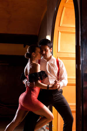 salsa dancer: A man and a woman in the most romantic dance: tango. Please see more images from the same shoot. Stock Photo