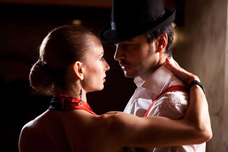 woman dancing: Close-up of a man and a woman dancing argentinian tango. Please see more images from the same shoot. Stock Photo