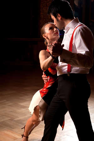 tangoing: Beautiful dancers performing an argentinian tango. Please check similar images from my portfolio.