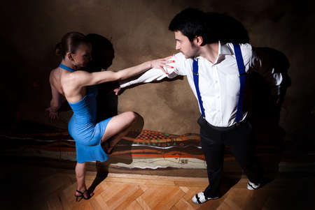 A man and a woman dancing argentinian tango. Please see more images from the same shoot. photo