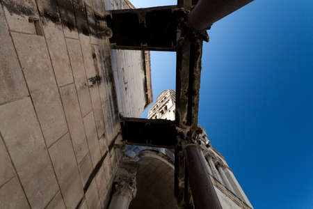 Unusual angle of Diocletian palace ruins and cathedral bell tower, Split, Croatia