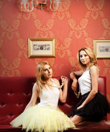 Two fashionable blond girls in tutu dresses  Please see more images from the same shoot  photo