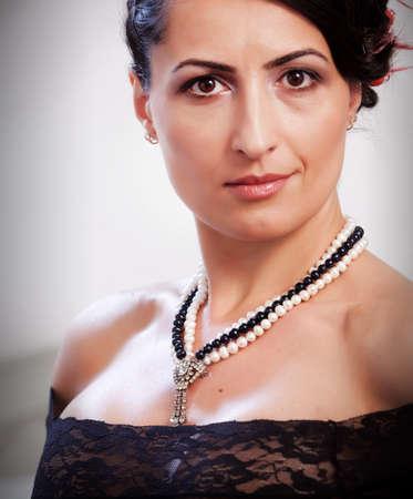 Mature woman portrait in black lingerie  Focus on the necklace Stock Photo - 13231640