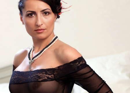 Mature woman portrait in black lingerie  Stock Photo