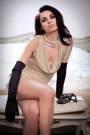 Young gorgeous brunette in sexy dress  Focus on the necklace