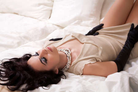 Portrait of a young gorgeous brunette in sexy gown  Focus on her face