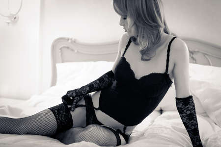 Young gorgeous blond woman in sexy lingerie posing in bed Stock Photo - 14242931
