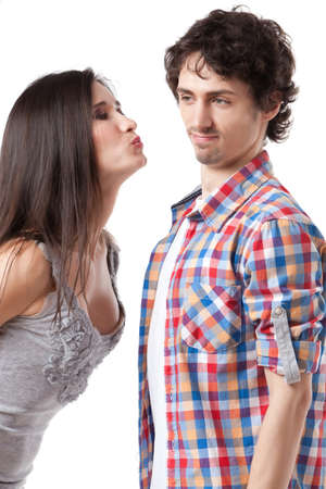 reject: Lovely young couple having fun by pretending that are kissing