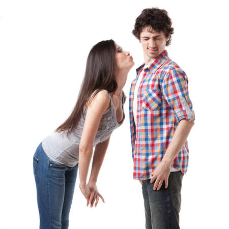 Lovely young couple having fun by pretending that are kissing