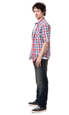 Young man in casual clothes posing over white background  photo