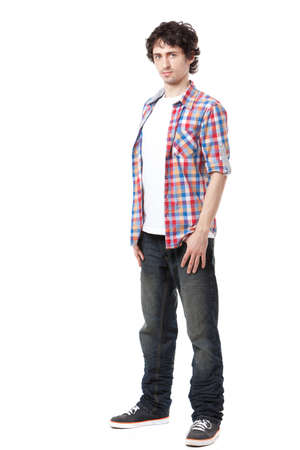 standing man: Young man in casual clothes posing over white background