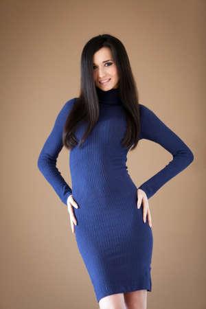 sexy sweater: Studio portrait of a lovely brunette posing