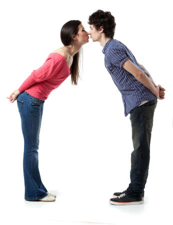 kissing couple: Lovely young couple having fun by pretending that are kissing