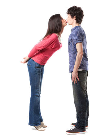 full length woman: Lovely young couple having fun by pretending that are kissing
