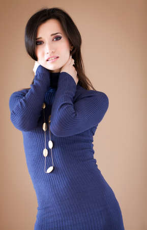 wolly: Studio portrait of a lovely brunette posing